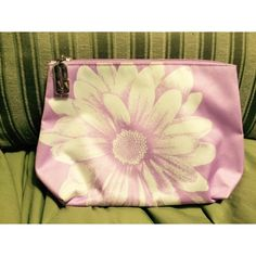 """Lavender cosmetic bag Lavender Clinique cosmetic bag with zipper closure. 6.5"""" x 10"""" x 3"""". A couple small makeup marks inside. Outside is clean. Clinique Bags Cosmetic Bags & Cases"""