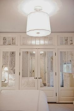 .I love the idea of mirrored closet doors like this