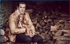 Dan May styles Werner Schreyer in a leather jacket, cashmere turtleneck sweater, and slim-fit denim jeans from Ralph Lauren Purple Label.