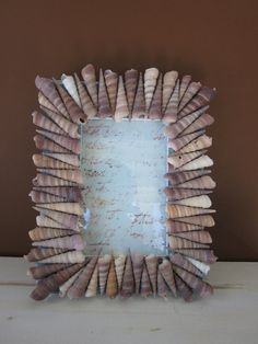Items similar to Seashell Picture Frame .Turritella Shells on Etsy,Items similar to Seashell Picture Frame .Turritella Shells on Etsy Frames are decorative accessories that surround the moments you immortalize. Seashell Picture Frames, Seashell Frame, Seashell Art, Seashell Crafts, Beach Crafts, Seashell Projects, Driftwood Projects, Driftwood Art, Shell Ornaments