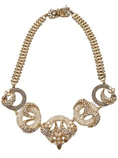 Pearl and crystal necklace in gold from Miriam Haskell for Decades. This vintage gold-plated brass necklace features five circular pendants adorned in Swarovski crystals and glass seed pearls, with box clasp closure. Measures 20