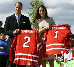William and Catherine receive hockey jerseys during a street hockey event in Yellowknife, Canada, on July 5, 2011. - TIMOTHY A. CLARY/AFP/Getty Images