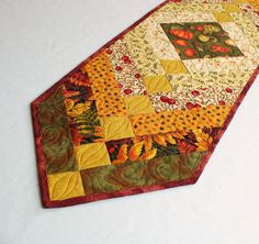 A lovely start for your Autumn Decorating - Fall Braid Quilted Table Runner. Use this on your dining room table, coffee table, dresser, kitchen