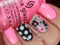 Light pink and black nails with flowers and dots
