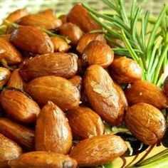 Roasted almonds are tossed with rosemary and garlic-infused olive oil for a fragrant and savory snack that everyone will enjoy.