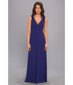 Sleeveless gown is fabricated from sophisticated poly georgette.. Plunging V-neckline.. Slight shir...