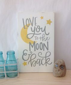 I love you to the moon and back  This 9x15 wood sign is hand sanded, stained and then hand painted with a hand lettered quote. A sawtooth hanger on back makes this wall decor ready to go! This is a beautiful piece that is perfect for a gallery wall, nursery, playroom. Great for a baby boy or baby girl. We cant wait to see it hanging in its new home!   Every sign is made with real wood and each piece of wood is unique. We take great care to pick beautiful wood and love the character that the…