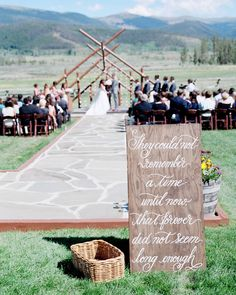 "One groom made wood signs to display at the entrance to the ceremony that were then calligraphed with quotes by Pink Ink Paper. One read, ""They could not remember a time until now, that forever did not seem long enough."" Another board quoted Dr. Seuss: ""When you are in love you can't fall asleep because reality is better than your dreams."""