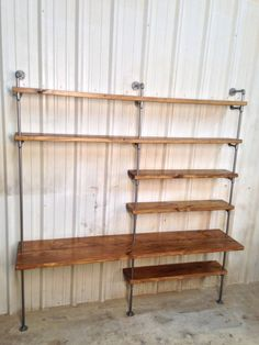 This is a custom hand-built industrial pipe shelving unit was recently completed…