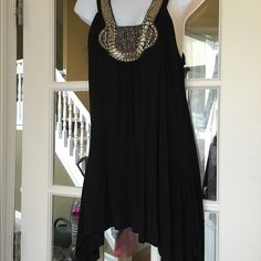 "Gorgeous Embellished Silver beaded Tank Top NWT Great sleeveless embellished black tank top. Sliver beads. Hi-low hem. Size : Large  Flat armpit to armpit 22"". Length at longest point 36"". Viscose (rayon)/spandex. Brand new with tags . C. Oliver Tops Tank Tops"
