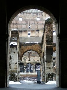 Colosseum with snow drifts inside, Rome, Italy.  http://www.tourabsurd.com/snowy-colosseum-rome-italy/