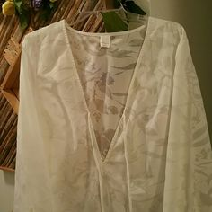 "Merona Sheer White Beach Coverup Light and airy coverup for the beach  - Size Large - Great condition,  only worn a few times - Billowy sleeves with slits (see 3rd pic) - Side slits on sides of dress - Ends about an inch above my knee and I'm 5'5"" Merona Swim Coverups"