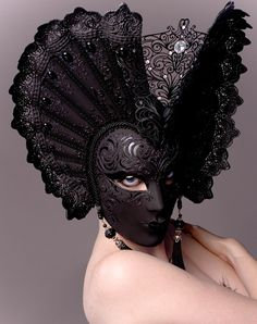 The juxtaposition of the black mask with the pale skin of the model makes for a striking image. The mask is a classic Venetian carnival mask invoking both the night and Venice's marriage to the sea. Photography by Natasha Epperson of the Illustrated Eye. Black Mode, Mode Bizarre, Gothic Mask, Madame Pompadour, Costume Venitien, Beautiful Mask, Carnival Masks, Venetian Masks, Masquerade Ball