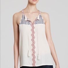 """Two By Vince Camuto White Embroidered Gauze Top. T19-Loaded with bohemian charm, this breezy gauze top from Two by VINCE CAMUTO flaunts hippie-chic, tassel-trimmed ties and front-facing embroidery for a look that perfectly captures summer's free-spirited vibe. 100%Cotton. Round split neck with tassel-trim ties, sleeveless, embroidered front Modified racerback, textured, semi-sheer, pullover style. Bust: 19"""", Lenght: 26"""". NWOT Two by Vince Camuto Tops Blouses"""