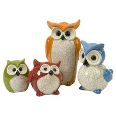 "KG...these would match your decor!!!!  Set of 4 multicolor ceramic owls with crackle glazes.    Product: Small, medium, large and extra large owl statuetteConstruction Material: CeramicColor: Green, red, orange, blue, and whiteDimensions: Small: 4.75"" H x 4"" W x 2.5"" DMedium: 5"" H x 5.5"" W x 4"" DLarge: 7"" H x 5"" W x 7"" DExtra Large: 9.75"" H x 5.5"" W x 3"" D"