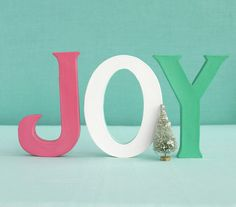 Use colorful paper letters to create a festive centerpiece.