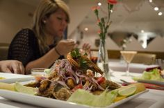 Think Italian trattoria, with jovial host, a plethora of liquors, large tables, party balloons and generous portions. Now, swap continents, and you have this Peruvian family-run restaurant in Walworth: http://www.timeout.com/london/restaurants/emanuel