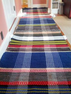 January 2013: three rugs fresh off the loom | mostly Iowa thrift store wool coats + wool scraps from friends | Swedish rosepath draft: Marguerite Davison