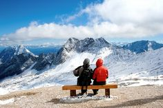 Two people enjoy the view of the Zugspitze in Bavarian, Germany. Shutterstock.com Stockphoto-ID: 262325393 #two #people #person #enjoy #relax #love #view #bench #seat #holiday #mountain #snow #summit #zugspitze #alps #germany #bavaria #garmischpartenkirche