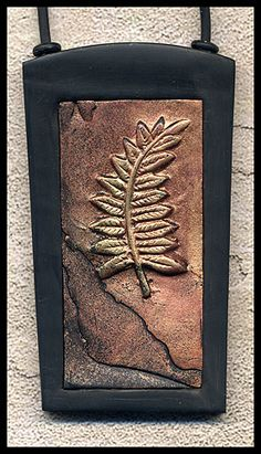 fossil leaf pendant--something similar with my copper clay?