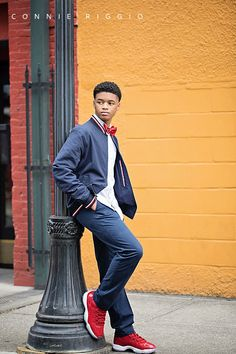 Colorful senior guy pictures are fun in the city. I love when props like red shoes and red bow tie make the picture pop even more. Guy Senior Poses, Boy Senior Portraits, Senior Boy Photography, Male Senior Pictures, Photography Poses For Men, Guy Pictures, Guy Poses, Boy Senior Pictures, Senior Photos