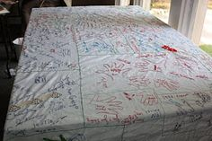A Thanksgiving Family Tradition Table Cloth (flat sheet).  Everyone writes what they are thankful for, name and year!  Going to start this! But make it neat and organized. :)