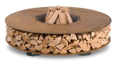 Inspiration: round outdoor fireplace, makes me wonder how to accomplish this with a cable reel
