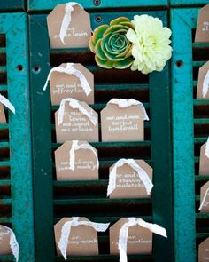 Calligraphed tags displayed in shutters serve as escort cards