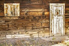 This rustic classic door and window with a horseshoe above each is on a western old barn in a mining town, my guess from the 1800's.  #FineArt #Photography #artwork #Gallery #interiordesign #commercialart - #Photo #Art from #Colorado to decorate your office, home, restaurant, boardroom, waiting room or any commercial space starting at $22 - #CorporateArt by #Photographer Copyright James Insogna www.BoInsogna.com