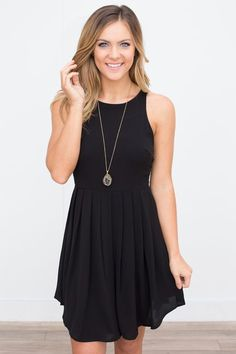 Shop our Solid Sleeveless Pleated Dress in black. The closet staple little black dress that everyone needs! Free shipping on all US orders!