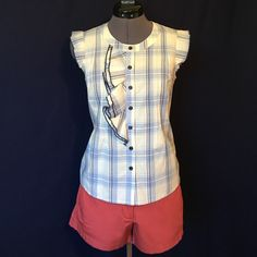 """Edme & Esyllte """"La Rosey Blouse"""" from Anthropolgie So Cute! """"A bookish delight of soft plaid, neat pintucks & ruffle trim."""" -Anthro. Pretty shades of blue plaid on a cream colored background, sleeveless, button front, bust darts, & pintucks for shaping. Bust measured flat across is approx. 16.5 inches, back of neck to hem is approx. 21.5 inches. 100% cotton. In perfect condition. Anthropologie Tops"""