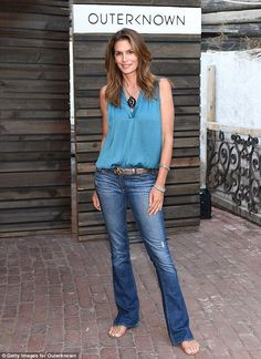 Looking great: At 49 Cindy Crawford looked fabulous in skinny flared jeans...