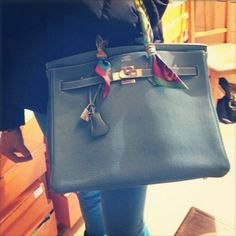 Birkin with scarf wrapped handles to protect the leather