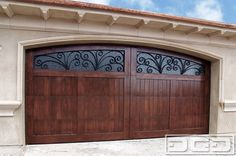 Italian Mediterranean Style Garage Doors with Decorative Iron Window Scrollings! garage and shed Garage Door Styles, Wood Garage Doors, Garage Door Design, Garage Door With Windows, Garage Cupboards, Wooden Doors, Iron Windows, Modern Garage, Villa