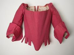 1730-1732 - Manchester City Galleries - Bodice for boy aged 5 to 7 in dark red speckled wool over very stiffly boned foundation, lined white glazed cotton printed in red with floral stem design