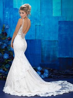 Beaded straps and neckline, deep plunging illusion back, fit and flare with layered lace illusion train. #weddingdress #allure