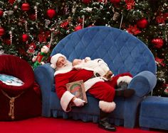The mall Santa helped a mom who had spent over 30 mins in line when her 8 month old fell asleep. He pretended to fall sleep with her baby in his arms.  What a wonderful man and a wonderful picture.