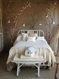 Combining large branches and Christmas lights for a cool bedroom idea