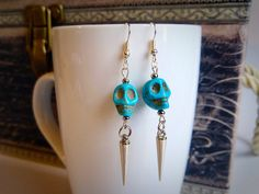 Turquoise skulls with silver spikes dangling earrings