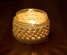 Recycle a used glass jar into a candle holder with a pretty crochet cover. PLEASE DO NOT MAKE JAR HOLDER HIGHER THAN THE JAR, AND NEVER LEAVE A LIT CANDLE UNATTENDED Materials: Size 6 crochet threa...