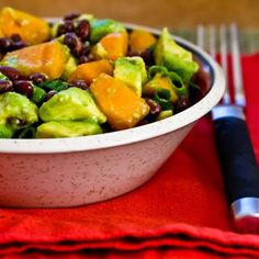 It's persimmon season in the U.S. and this Black Bean Salad with Fuyu Persimmon, Avocado, and Lime-Cumin Vinaigrette is a delicious way to use them! [from KalynsKitchen.com] #Persimmons