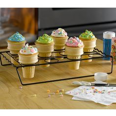 Now you can bake those fun ice cream cone cupcakes with no worries! The unique design of this nonstick rack keeps cones securely upright while baking in the oven, during cooling, and while decorating. Rack is stylish enough to use for serving too! Holds up to 12 medium or large cake cones, 13-1/2 wide x 9-1/2 deep x 2-1/2 high, dishwasher safe!