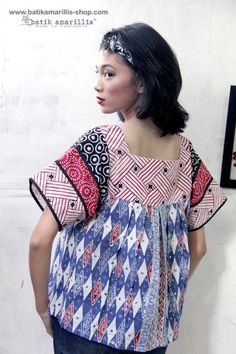 Batik Amarillis made in Indonesia proudly presents ...Frida blouse with the twist! This magnificent Mexican traditional blouse inspired is super pretty & comfy with its bold & beautiful style . Armed with charming and playful batik patchwork which make this is so unique and special!