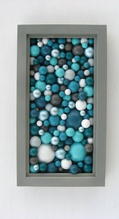 Cheap dollar store ornaments, and put them in a shadow box - Click image to find more DIY & Crafts Pinterest pins