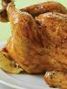 Whole Barbecued Chicken -- Ready for the grill after just 10 minutes of prep, this chicken recipe is the summertime version of winter's best comfort food.