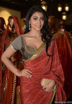 Shriya Saran red saree blouse low cut cleavage at Jhelum store Mumbai