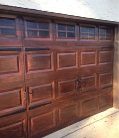 We recently painted our house and so our garage door needed to be painted as well. I decided not to repaint it because I was hoping the old rust paint would sho… Faux Wood Garage Door, Metal Garage Doors, Garage Door Paint, Garage Door Makeover, Metal Garages, Garage Door Design, Faux Garage Door Windows, Big Doors, Faux Window