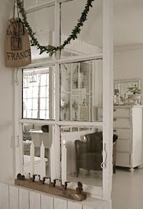 Idea - put a window in where the weird bookshelf/square block thingy is between the living room and kitchen...