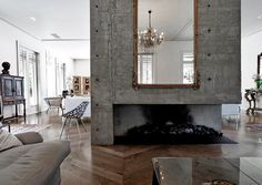 """We found ourselves curiously relieved when we came across this very modern space whose design was """"broken"""" by classical antiques, a far cry from many of today's sterile mid-century-esque interiors. But we weren't crazy about the fussy chandeliers that festoons the place, so we photoshopped one out TO SEE WHAT WOULD HAPPEN."""