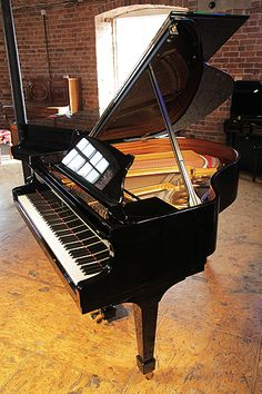 A 2005, Steinway Model S baby grand piano with a black case and spade legs at Besbrode Pianos £36,000